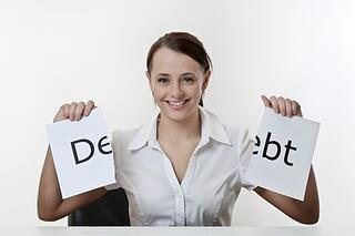woman_holding_ripped_debt_sign