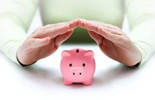 woman protecting savings in piggy bank