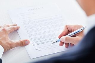person_co_signing_document