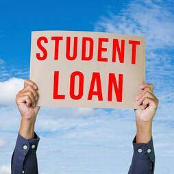 person_holding_student_loan_sign