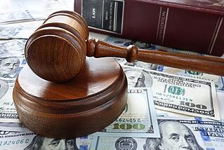 court gavel and money in lawsuit