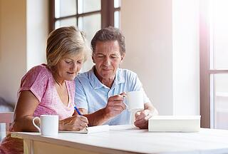 retired_couple_looking_at_finances