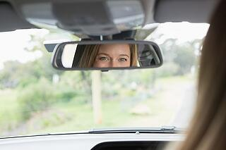 woman_looking_in_rearview_mirror