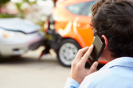 475398145_man calling car accident lawyer