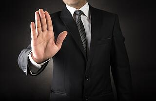 man with hand motion saying stop