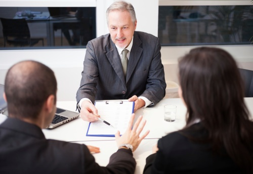 personal injury lawyer talking with clients