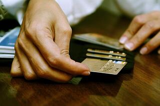 person using credit cards