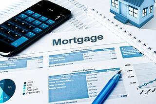 mortgage papers and calculator