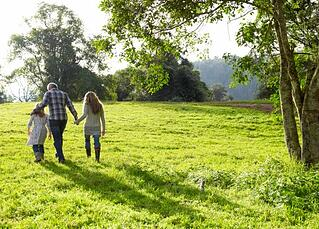 parents and child walking