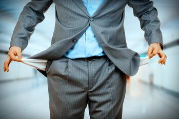 A_businessman_with_empty_pockets