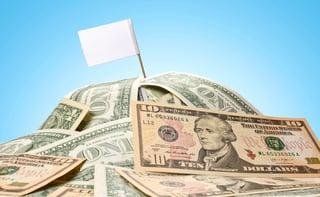 white_flag_flying_over_a_pile_of_cash