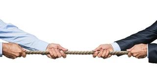 two_men_tugging_at_rope.jpg