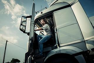 truck_driver_stepping_out_of_truck