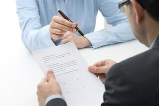 Signing a loan agreement.