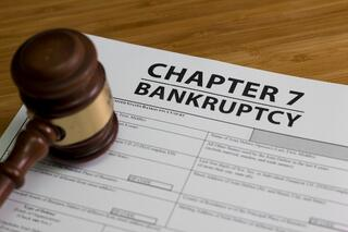 A gavel on a Chapter 7 bankruptcy document.