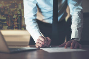 close-up-business-man-signing-contract-PFC4A2S