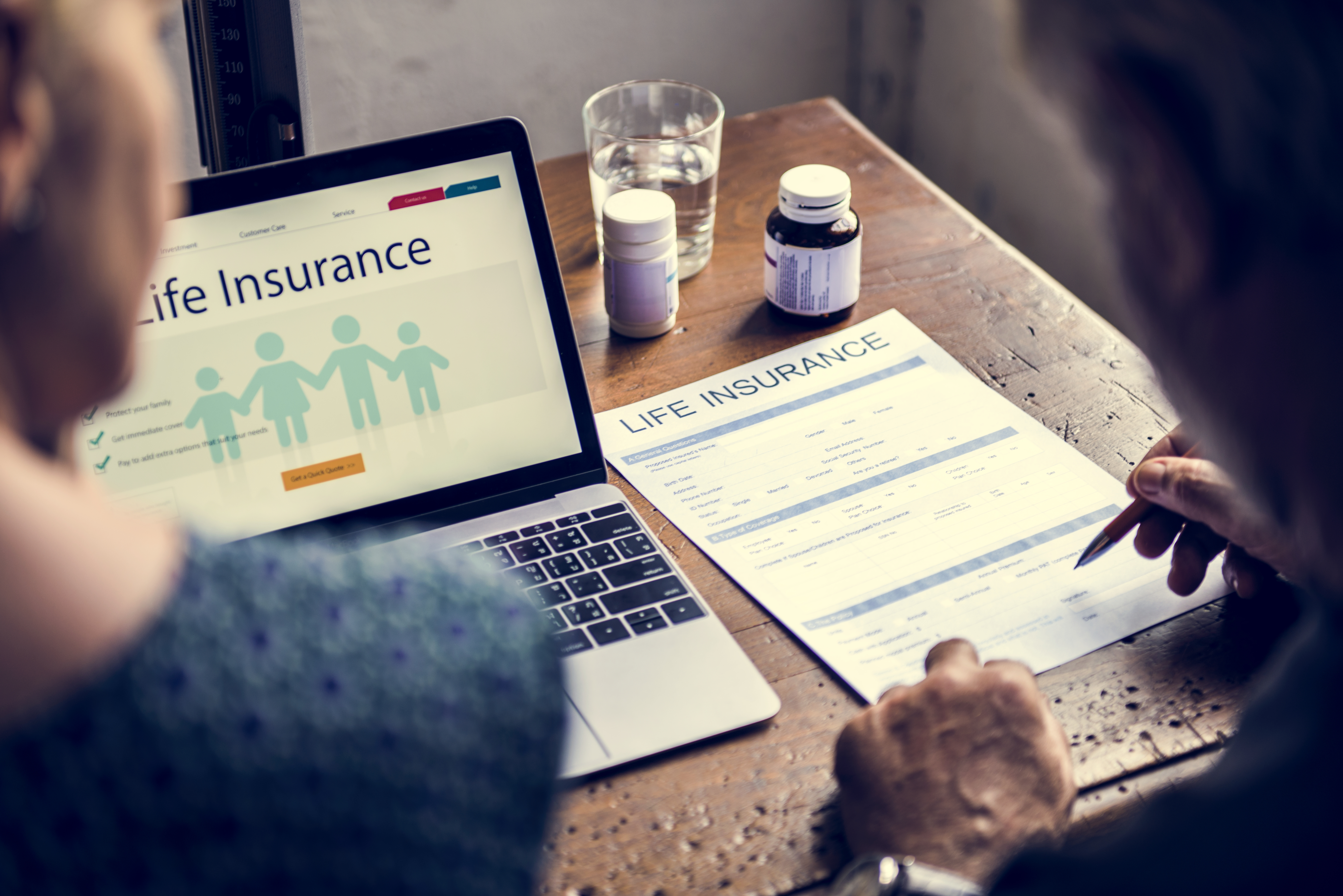 couple-reviewing-life-insurance-policy