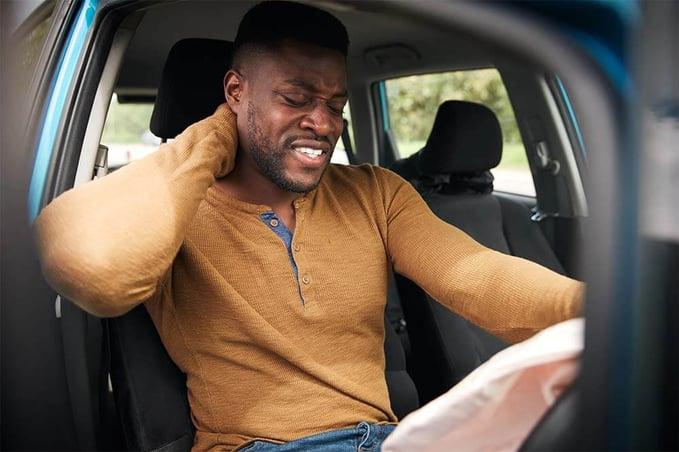 male-motorist-with-whiplash-injury-in-car-crash-62GK9N8 (1)-1