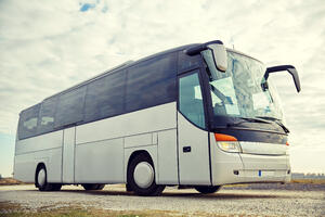 tour-bus-driving-outdoors-PYK8KJ6