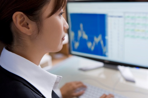 126435465_business woman looking at financials.jpg