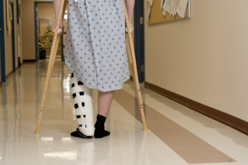 87500432_man_in_hospital_on_crutches.jpg