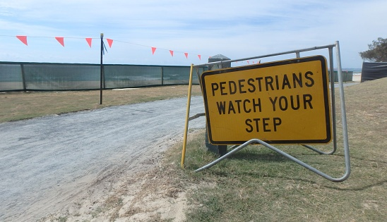 pedestrians watch your step sign - ThinkstockPhotos-619371196.jpg