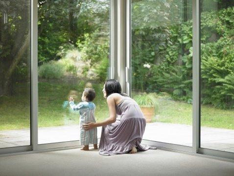 mother_and_son_looking_out_window